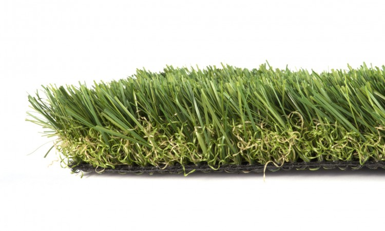 11144418 - patch of green artificial grass on a white background